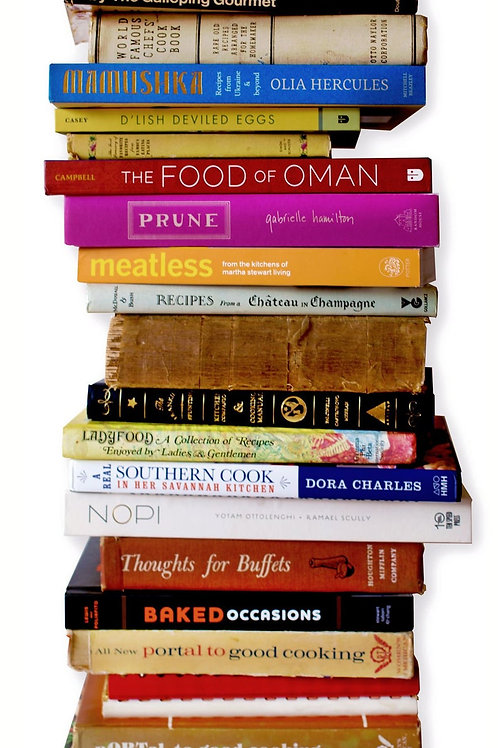Photograph of a tall stack of vintage cookbooks for A Vintage Addiction Cookbook Sampler Subscription Boxes