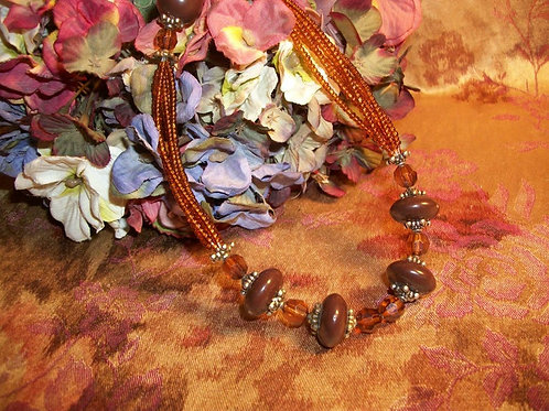 """Pretty Translucent Root Beer Colored Seed and Faceted Beads Round and Oval Brown Beads Silver-Tone Accents 18 1/2"""""""