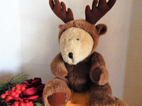 Photograph of a teddy bear dressed as a reindeer, a vintage Christmas toy decoration from A Vintage Addiction