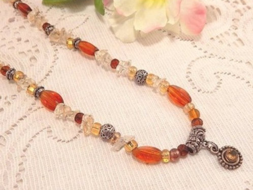 Beaded Pendant Necklace Amber and Clear Beads with Silver Metal Medallion Adjustable 22 Inch Strand Vintage 1980's Jewelry