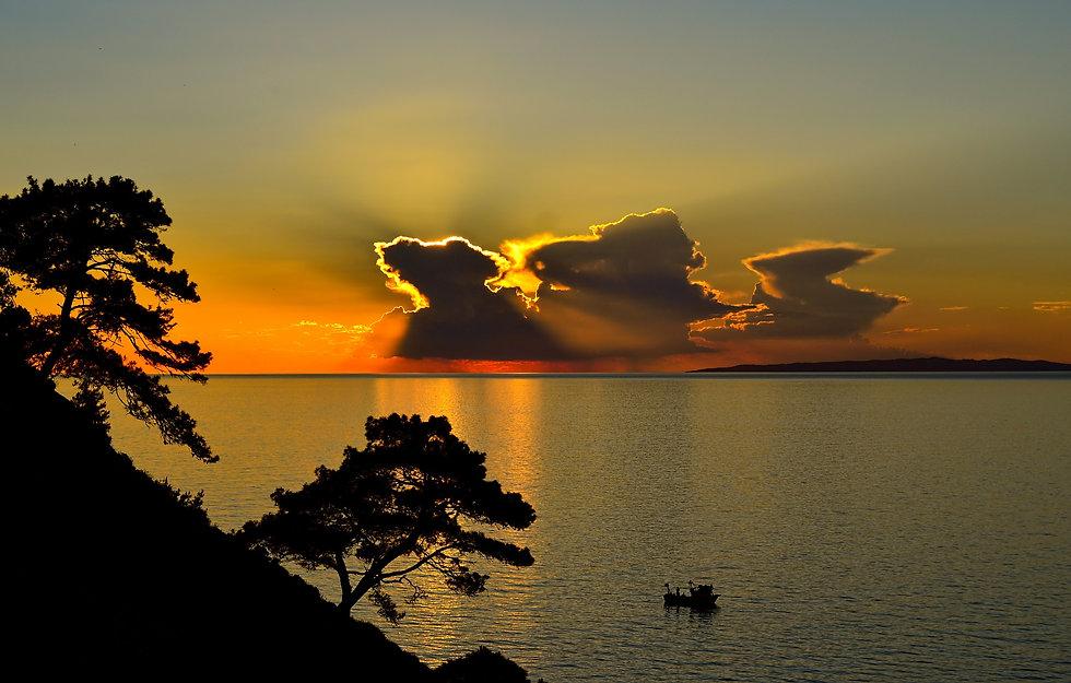 boat-clouds-dawn-459400.jpg