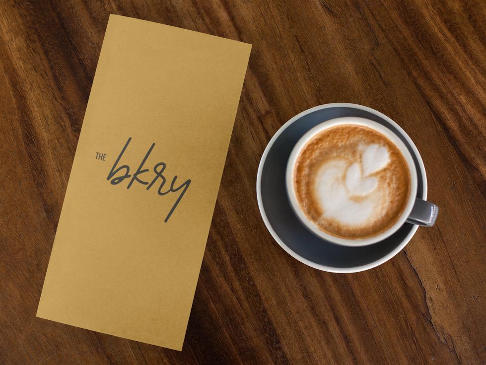 coffee-shop-menu-lying-next-to-a-latte-c