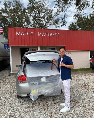 Happy customer goes home with a Twin mattress!