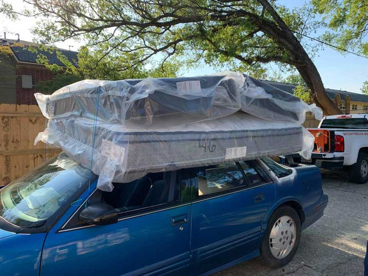 King size mattress by Serta on top of the car in Pensacola, Florida
