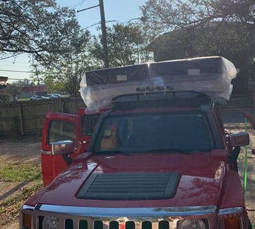 King Mattress and Box spring on top of the JEEP