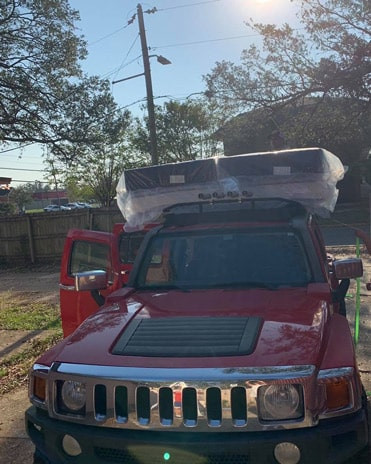 King size mattress set on top of the Jeep