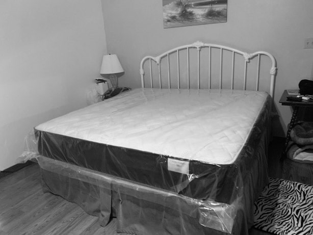 Country Bed Style set up with mattress near Pensacola, Florida