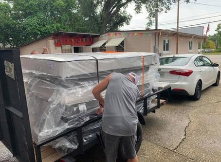 Small Kia car will pull a trailer with mattresses!