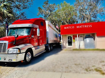 Truck full of mattresses ready for Black Friday deals!