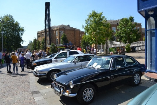 MG BGT and Jag beside American police muscle