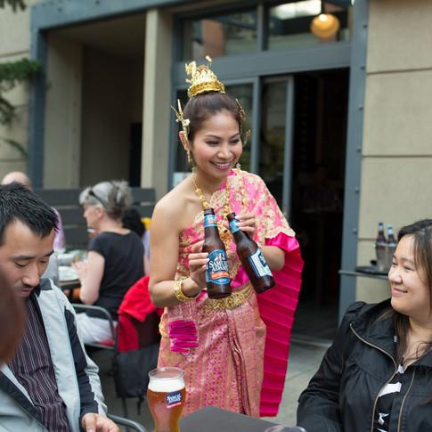 Thai Waitress serving Sam Adams Beer