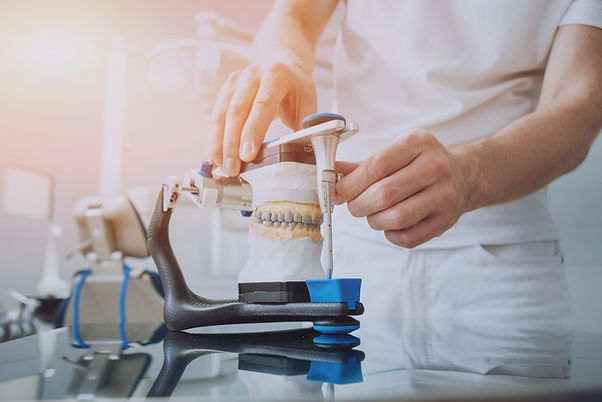 dental-technician-working-with-articulat