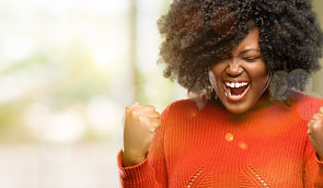 Beautiful african woman happy and excite