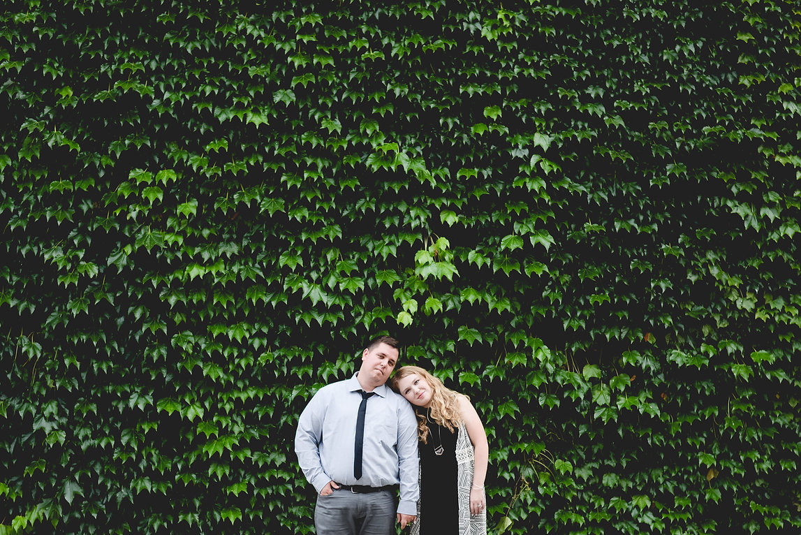 Engagement photoshoot. Vine wall. Couples