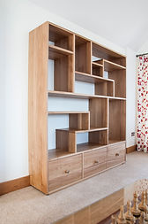 A solid oak contemporary display cabinet.