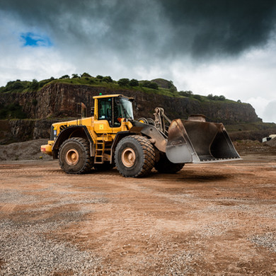 a large industrial loader in an open quarry