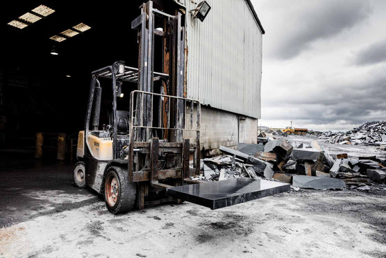 fork lift truck in slate quarry, industrial photo
