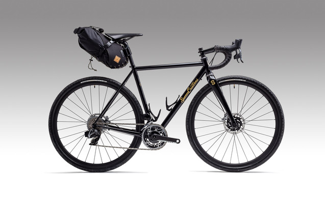 catalogue shot of Spoon Customs gravel bike with restrap bag