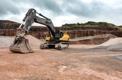 a large industrial digger in an open quarry