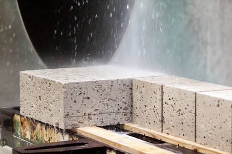 portland stone being cut into blocks by a saw