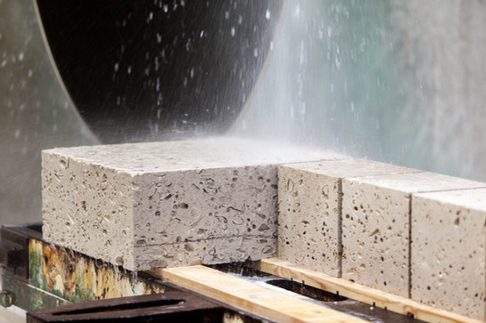 portland stone being cut into blocks by a saw