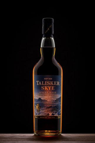 whisky bottle on black background