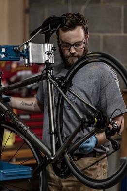 man checking a bike wheel