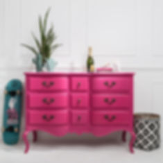 Styled photography of a pink chest of drawers and home accessories for Out There Interiors, by product photographer Simon Eldon