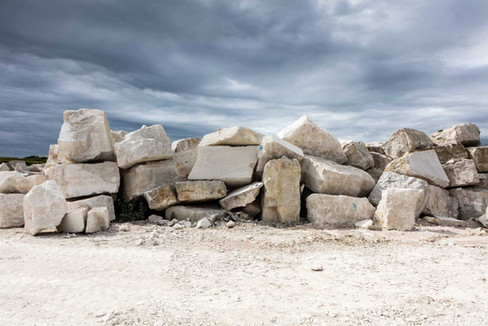 pile of large white rocks with moody sky