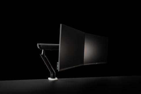 computer monitors on black background