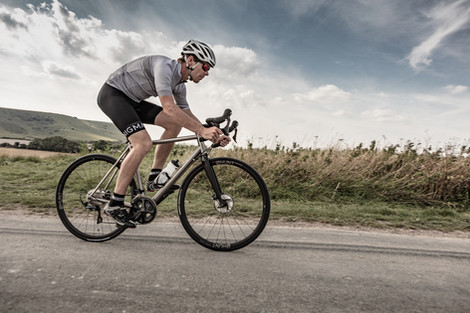 Enigma Lifestyle shot of cyclist on road