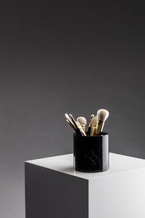 marble pot with Tom Ford brushes, product photography