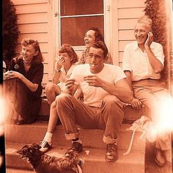 1950s Family Sitting On Steps Suburbia v