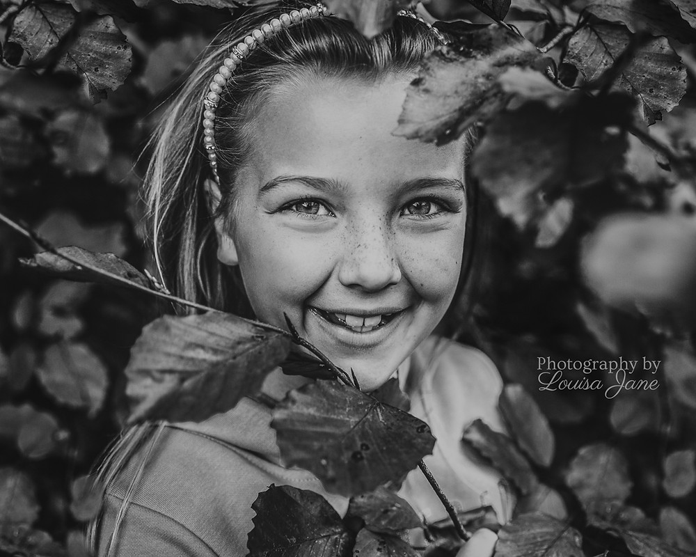 Little girl in autumnal bush, Black and white photography, Dorset Family Photographer, Somerset Family Photographer, Wiltshire Family Photographer, Award-winning Photographer, Christmas Offer