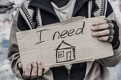 Young homeless man holding sign _I need home_.jpg