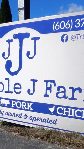 "Tripple J Farm 8"" sign"
