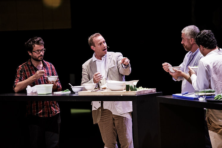 Three prominent cooks, discussing, cooking and tasting.