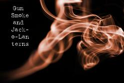 Gun Smoke & Jack-o-Lanterns, by Kingston. orange smoke on dark background.