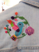 Hand-embroidered humming bird and flowers on jean jacket