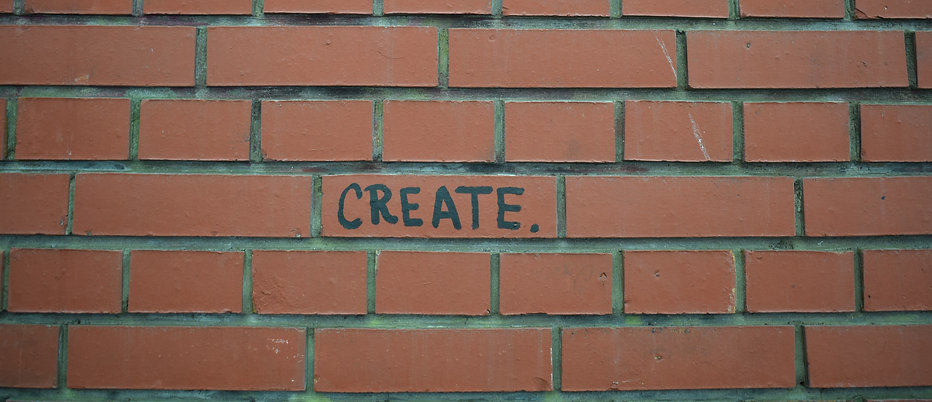 "Red bricks with ""Create"" painted on them."