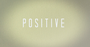 """Abstract tan background with text, """"Positive."""""""