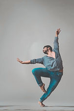 dancing-man-wearing-pants-and-long-sleev