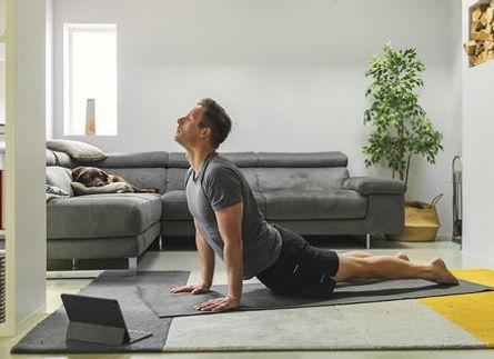 man-practising-yoga-at-home-royalty-free