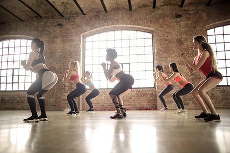 group-of-women-doing-exercise-inside-the