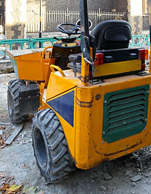 Dump truck with front bucket at construc