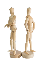 Two wooden human figures being standoffish, facing away from each other