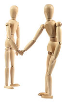 two wooden human figures shaking hands