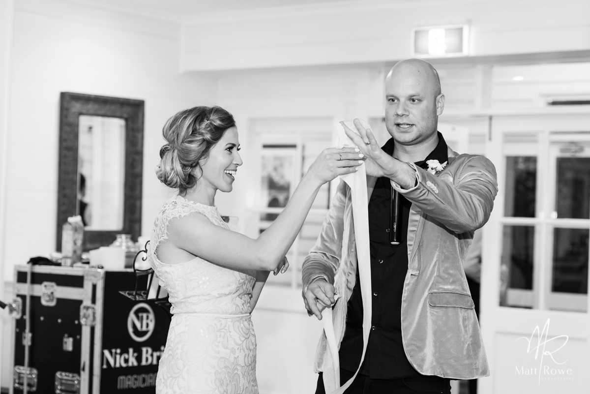 Magician does magic at wedding