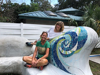 Melissa Haist and Rochelle Rose-Schueler posing on mosaic public art bench project