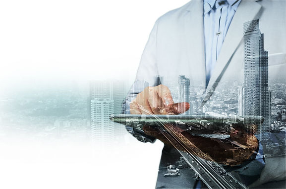Double exposure of city and businessman